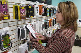 Photo of customer looking at phone accessories